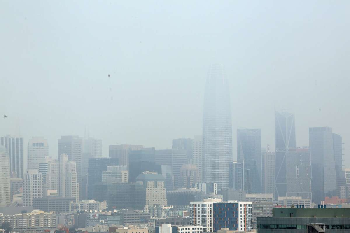 Buildings in downtown San Francisco are seen through a hazy sky on Monday, August 24 2020 in San Francisco, Calif.