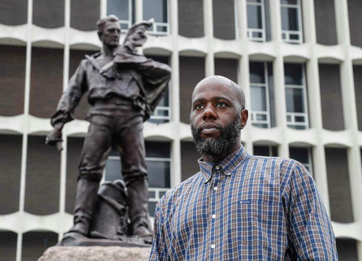 """Isaac Fanuiel IV, who is advocating for a Confederate statue called the """"Dignified Resignation"""" statue to be removed from in front of the Galveston County courthouse, is shown on Friday, June 26, 2020, in Galveston. A motion to remove the statue did not receive a second at a meeting of the county commissioners on Aug. 24, 2020 and died."""