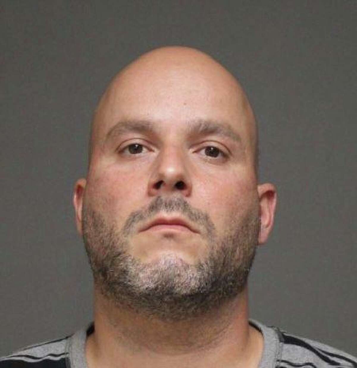 Steven Botelho, a 38-year-old Bridgeport resident, has been arrested for allegedly causing a large fire near the Metro North train tracks with illegal fireworks, according to police.