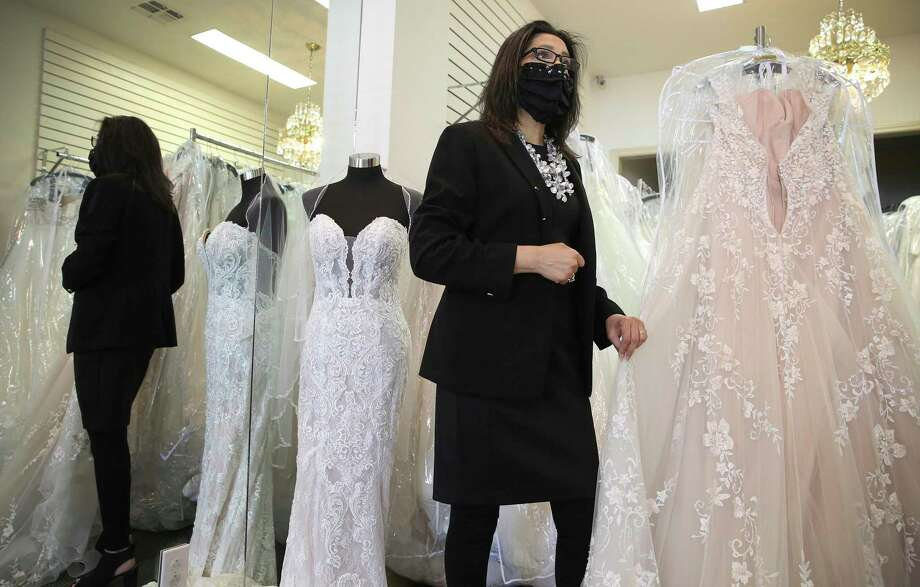 Teresa Ashmore, owner of Brides by Elizabeth, a family-owned bridal shop, discusses how she and her business has weathered the pandemic despite restrictions on gatherings. Photo: Kin Man Hui /Staff Photographer / **MANDATORY CREDIT FOR PHOTOGRAPHER AND SAN ANTONIO EXPRESS-NEWS/NO SALES/MAGS OUT/ TV OUT