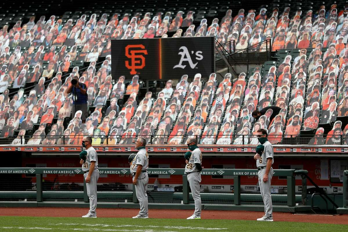 Oakland Athletics' coaches Al Pedrique, Mike Aldrete and Ryan Christenson and manager Bob Melvin stand for National Anthem before playing San Francisco Giants during MLB game at Oracle Park in San Francisco, Calif., on Sunday, August 16, 2020.