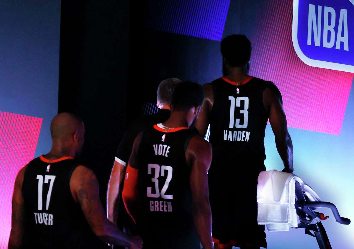 James Harden, Jeff Green and P.J. Tucker leave the court following a loss to Oklahoma City that evened the series at 2-2.