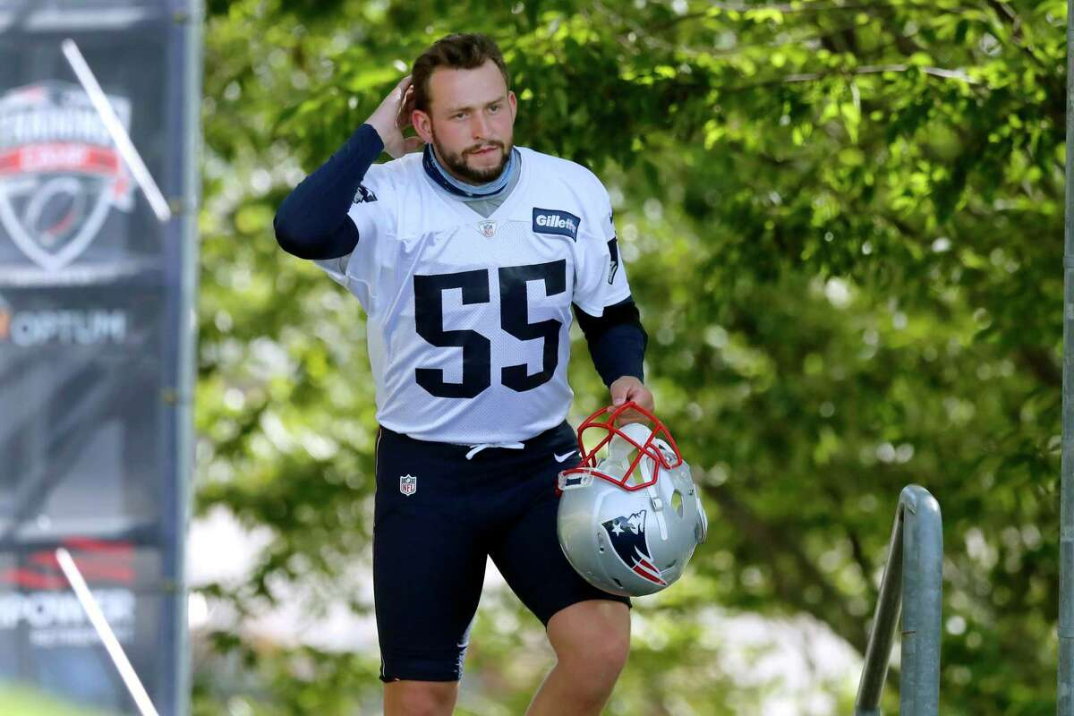 New England Patriots kicker Justin Rohrwasser walks to the field for an NFL football training camp practice, Friday, Aug. 21, 2020, in Foxborough, Mass. (AP Photo/Michael Dwyer, Pool)