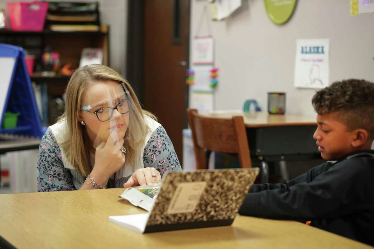 Kirston Boston checks in with each of her 3rd-grade class at Humble Elementary School Monday, Aug. 24, 2020, in Humble.