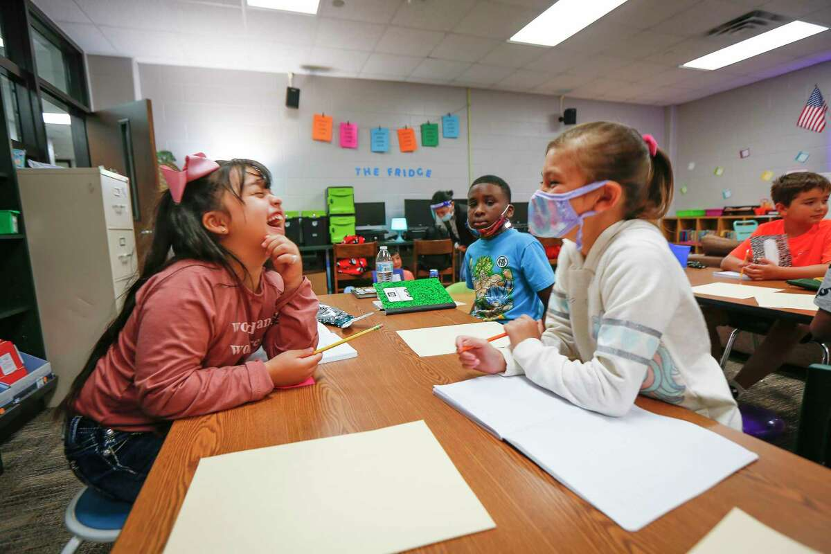 Humble Elementary School third-graders Kimberly Chapa, left, and Reyna Johnson, work on an assignment during the first day of class on Aug. 24. Humble ISD is reporting 17 known active cases of COVID-19 among the roughly 34,000 students and staff who are spending time on campuses, with no known outbreaks in the first four weeks of classes.