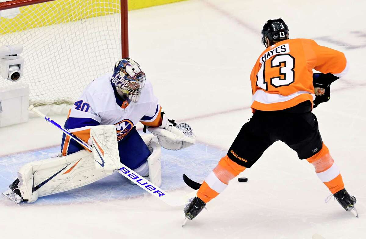 New York Islanders goaltender Semyon Varlamov (40) makes a save against Philadelphia Flyers centre Kevin Hayes (13) during first-period NHL Stanley Cup Eastern Conference playoff hockey game action in Toronto, Monday, Aug. 24, 2020. (Frank Gunn/The Canadian Press via AP)