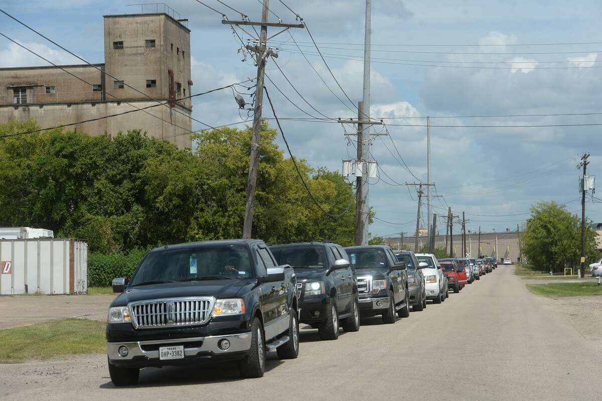 Long lines of vehicles stretched down S. Fourth and Cedar Streets Monday afteroon as the city openned the former recycling center for sandbag distribution in preparation for this week's storms. Photo taken Monday, August 24, 2020 Kim Brent/The Enterprise