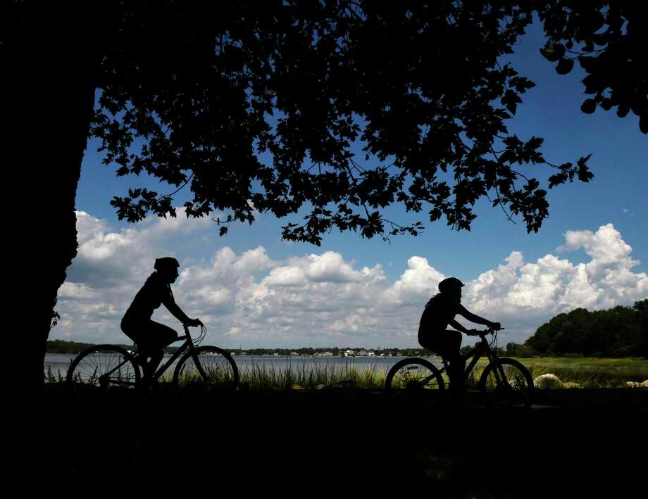 Cyclists go for a ride along the Tod's Driftway loop on a sunny day at Greenwich Point Park on Monday, when the high temperature reached the low 90s. Photo: Tyler Sizemore / Hearst Connecticut Media / Greenwich Time