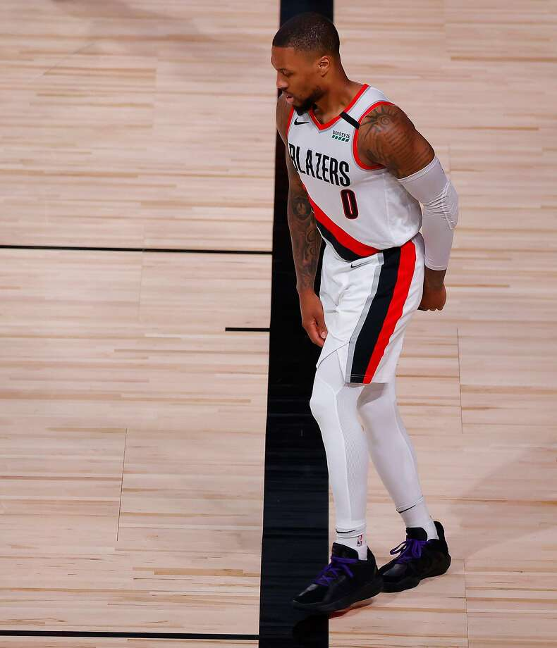 LAKE BUENA VISTA, FLORIDA - AUGUST 24: Damian Lillard #0 of the Portland Trail Blazers limps after drawing a foul against the Los Angeles Lakers during the third quarter in Game Four of the Western Conference First Round during the 2020 NBA Playoffs at AdventHealth Arena at ESPN Wide World Of Sports Complex on August 24, 2020 in Lake Buena Vista, Florida. NOTE TO USER: User expressly acknowledges and agrees that, by downloading and or using this photograph, User is consenting to the terms and conditions of the Getty Images License Agreement. (Photo by Kevin C. Cox/Getty Images) Photo: Kevin C. Cox / Getty Images