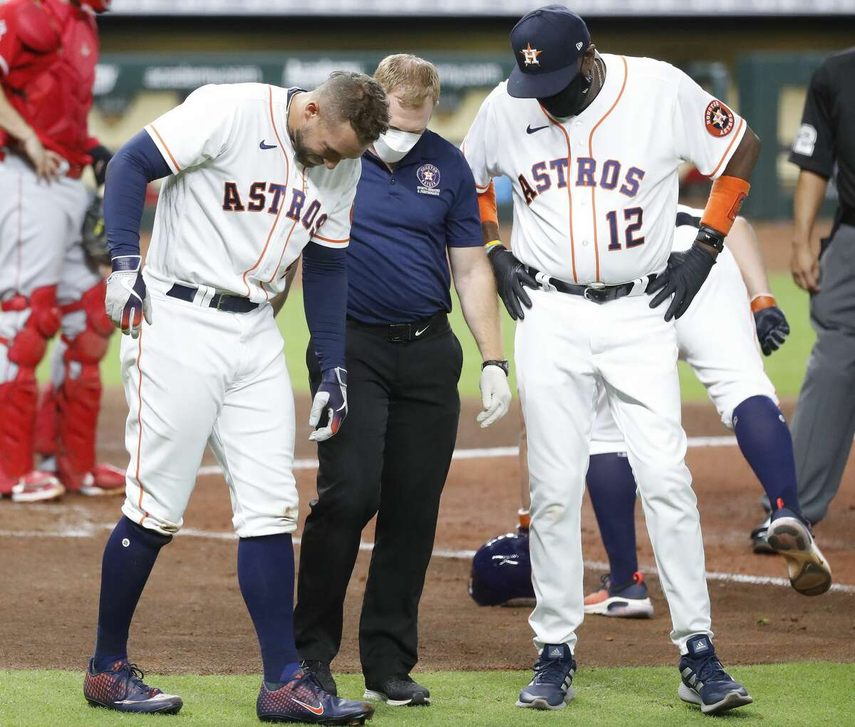 Houston Astros George Springer (4) reacts after getting hit by a pitch on his hand during the sixth inning of an MLB baseball game at Minute Maid Park, Monday, August 24, 2020, in Houston.