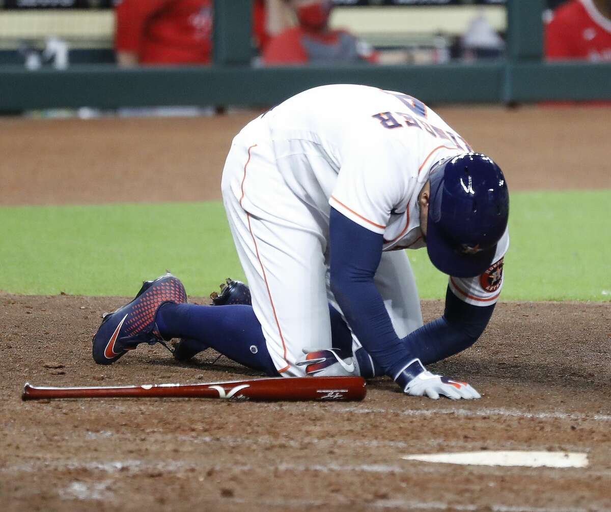 Houston Astros George Springer (4) crumbles to the ground after getting hit by a pitch on his hand during the sixth inning of an MLB baseball game at Minute Maid Park, Monday, August 24, 2020, in Houston.