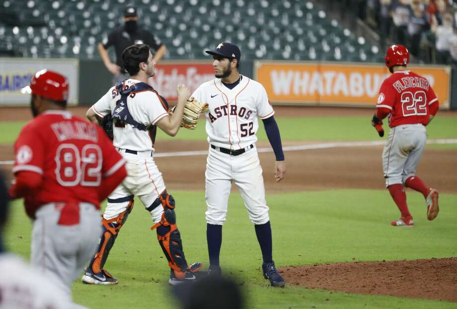 PHOTOS: More from the Astros win over the Angels on Monday night Houston Astros relief pitcher Cionel Perez (52) celebrates with catcher Garrett Stubbs (11) after the Astros 11-4 win over the Los Angeles Angels after he struck out Jason Castro to end the ninth inning of an MLB baseball game at Minute Maid Park, Monday, August 24, 2020, in Houston. Photo: Karen Warren/Staff Photographer / © 2020 Houston Chronicle