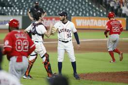 Houston Astros relief pitcher Cionel Perez (52) celebrates with catcher Garrett Stubbs (11) after the Astros 11-4 win over the Los Angeles Angels after he struck out Jason Castro to end the ninth inning of an MLB baseball game at Minute Maid Park, Monday, August 24, 2020, in Houston.