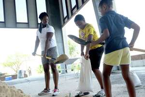 The pavilion in Port Arthur is filled with sandbaggers, including Shaketha Fontenette, with nephew Dakovin Martin and daughter Alexandra Johnnson, as area residents prepare for Marco and Laura's hit to the region this week. Photo taken Monday, August 24, 2020 Kim Brent/The Enterprise