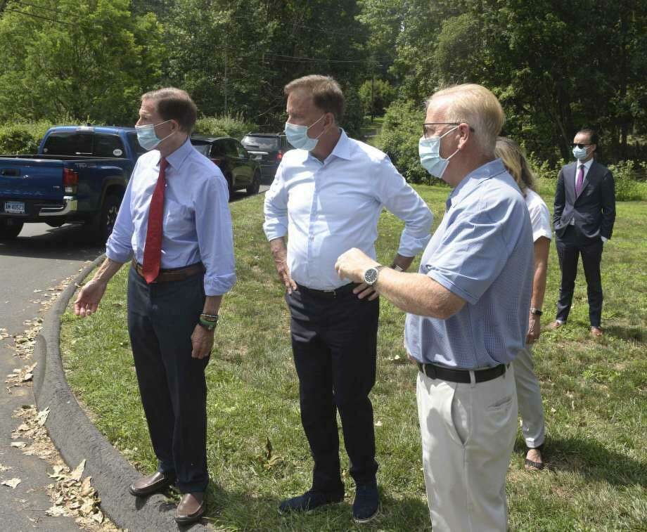 U.S. Sen. Richard Blumenthal, Gov. Ned Lamont and Mayor Mark Boughton (L-R), assessing power restoration efforts in August 2020 in Danbury, Conn., where hundreds of Eversource customers remained without electricity a week after Tropical Storm Isaias. Photo: H John Voorhees III / Hearst Connecticut Media