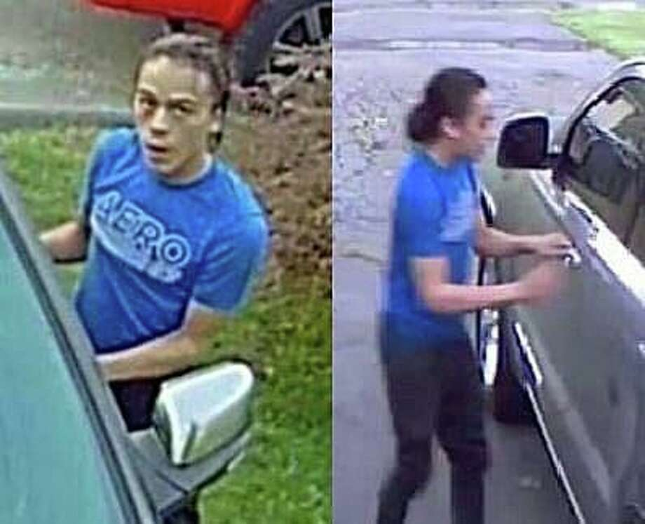 "Police are attempting to identify a male involved in trespassing and attempts to enter vehicles in Watertown. ""The male appears to be approximately 18 years old with a slim build, wearing a blue T-shirt and black pants. He had long dark hair which was tied up in a man bun,"" State Police posted on Facebook. Photo: Watertown Police Photo"
