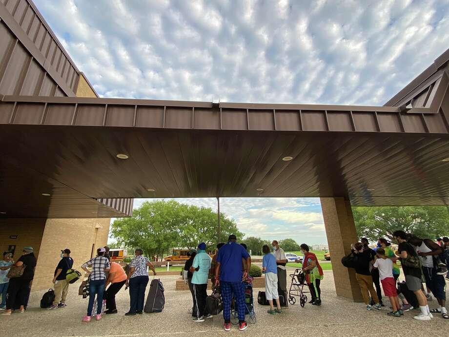 Port Arthur residents prepare to evacuate at the Bob Bowers Civic Center in advance of Hurricane Laura's landfall. Photo: Kim Brent/The Enterprise