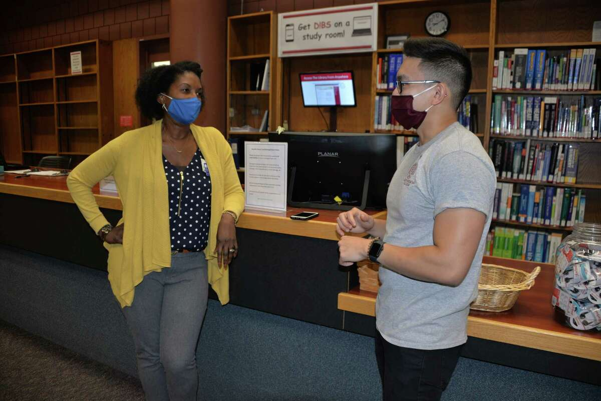 Albany Medical Center's chief officer of Health Equity, Diversity and Inclusion, Dr. Angela Antonikowski, left, talks with Dan Tu, desktop support specialist in the Schaffer Library of Health Sciences. (Provided)