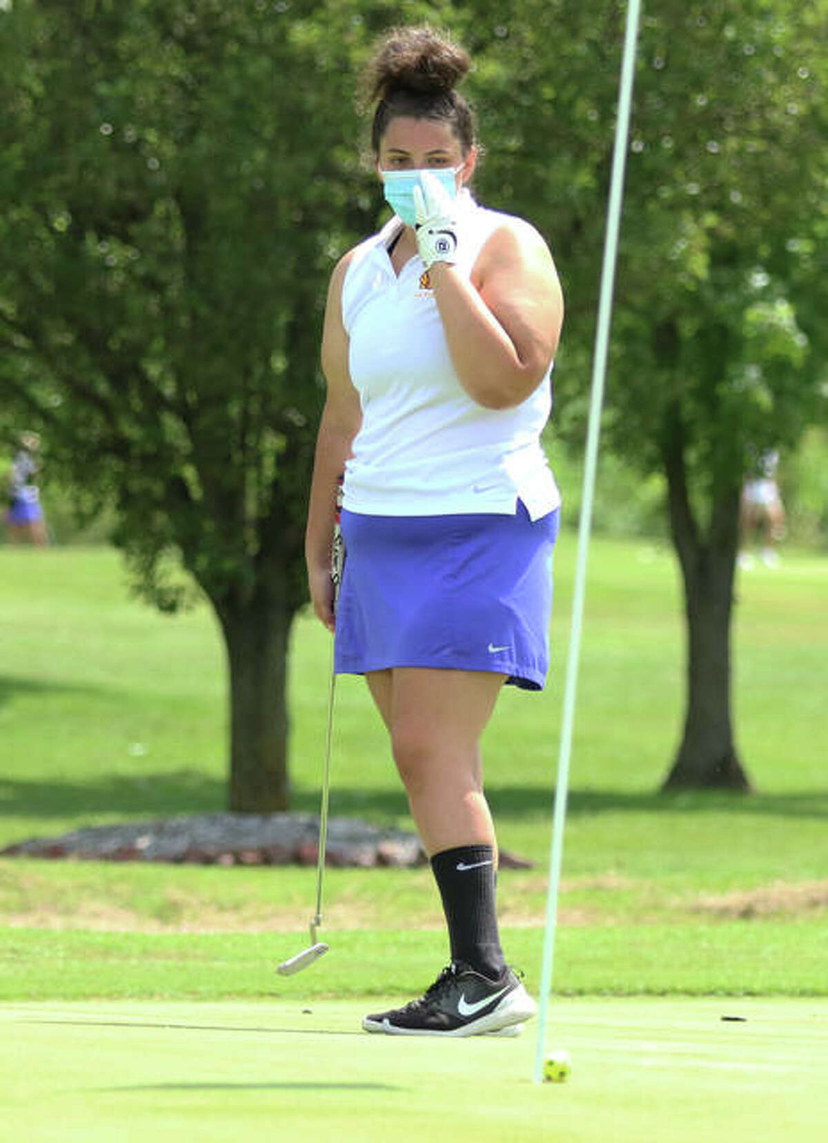 Roxana's Sarah Floyd watches her putt roll into the cup on the seventh hole at The Legacy golf course in last Tuesday's Madison County Tournament in Granite City. On Monday, Floyd shot 48 to help the Shells go 1-1 in a triangular at Cloverleaf in Alton.