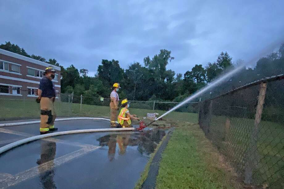 Here, Haddam Volunteer Fire, Chester Hose, and Killingworth Volunteer Fire companies participate in a tanker shuttle drill Aug. 17. Photo: Olivia Drake Photo / Haddam Volunteer Fire