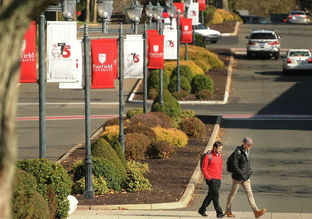 Students walk between classes on the Fairfield University campus in Fairfield, Conn. on Wednesday, November 15, 2017.