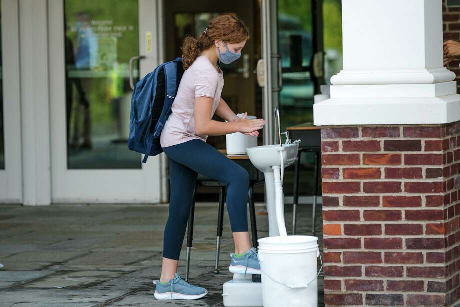 SLS student Olivia Gaumer '27 of New Canaan using the school's hand washing station. Photo: Keyz 2 Life Media / @ St. Luke's School