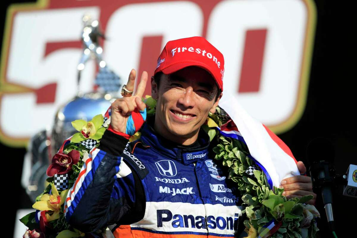 Takuma Sato, driver of the #30 Panasonic / PeopleReady Rahal Letterman Lanigan Racing Honda, celebrates in Victory Lane after winning the 104th running of the Indianapolis 500 at Indianapolis Motor Speedway on August 23, 2020 in Indianapolis, Indiana.