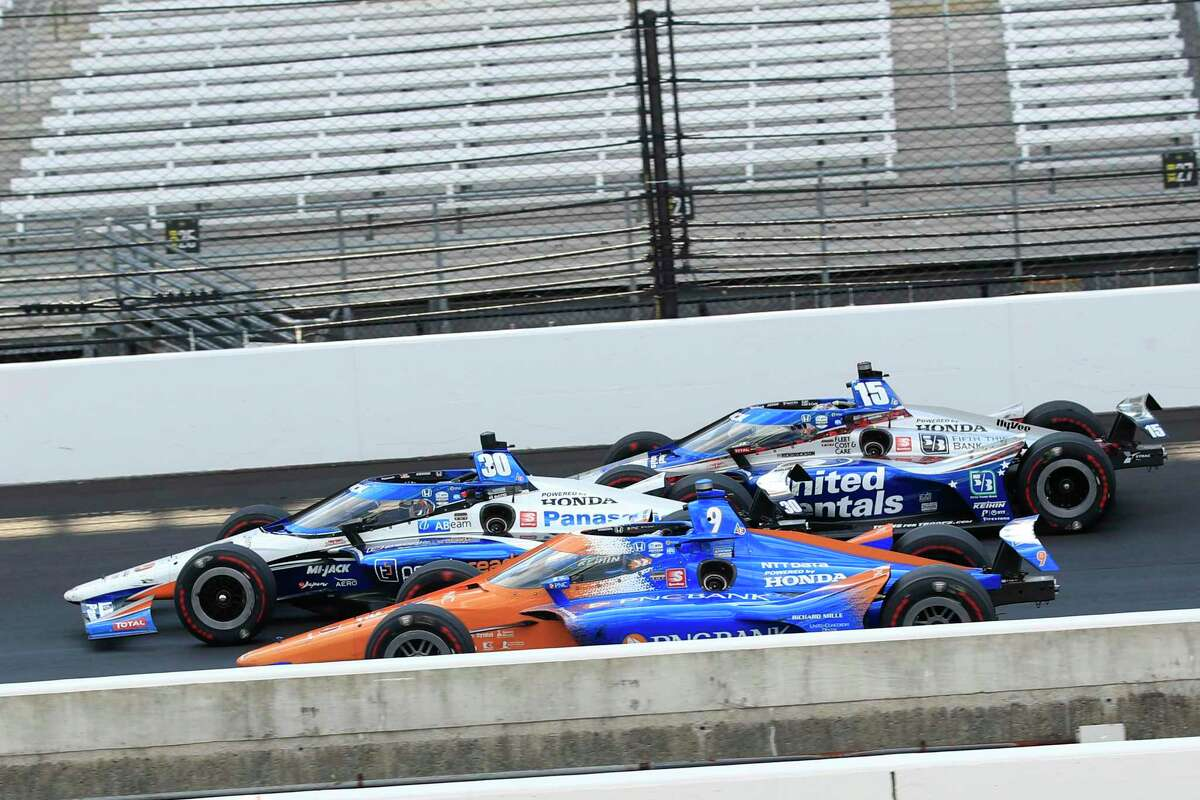 Takuma Sato, driver of the #30 Panasonic / PeopleReady Rahal Letterman Lanigan Racing Honda, wins ahead of Scott Dixon, driver of the #9 PNC Bank Chip Ganassi Racing Honda, and Graham Rahal, driver of the #15 United Rentals Rahal Letterman Lanigan Racing Honda, during the 104th running of the Indianapolis 500 at Indianapolis Motor Speedway on August 23, 2020 in Indianapolis, Indiana.