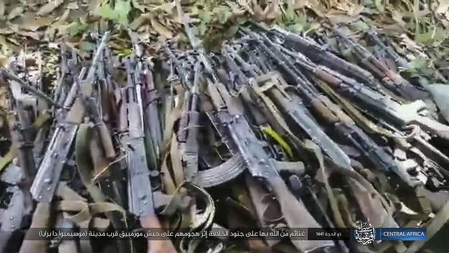 "This image distributed online by the Islamic State Central Africa Province (ISCAP) and provided by SITE Intelligence Group shows weapons piled up following clashes with Mozambican government troops on Thursday, Aug. 6, 2020, near Mocimboa da Praia, in northern Mozambique. The stinging success of Mozambique's Islamic extremist rebels in seizing and holding the northern port city signals to the government, neighboring countries and the world that Africa has yet another insurgency hotspot. Writing in Arabic reads ""Blessings of God are on the soldiers of the caliphate after their attack on the Mozambican army near the city of Mocimboa da Praia"". (SITE Intelligence Group via AP) Photo: Associated Press"