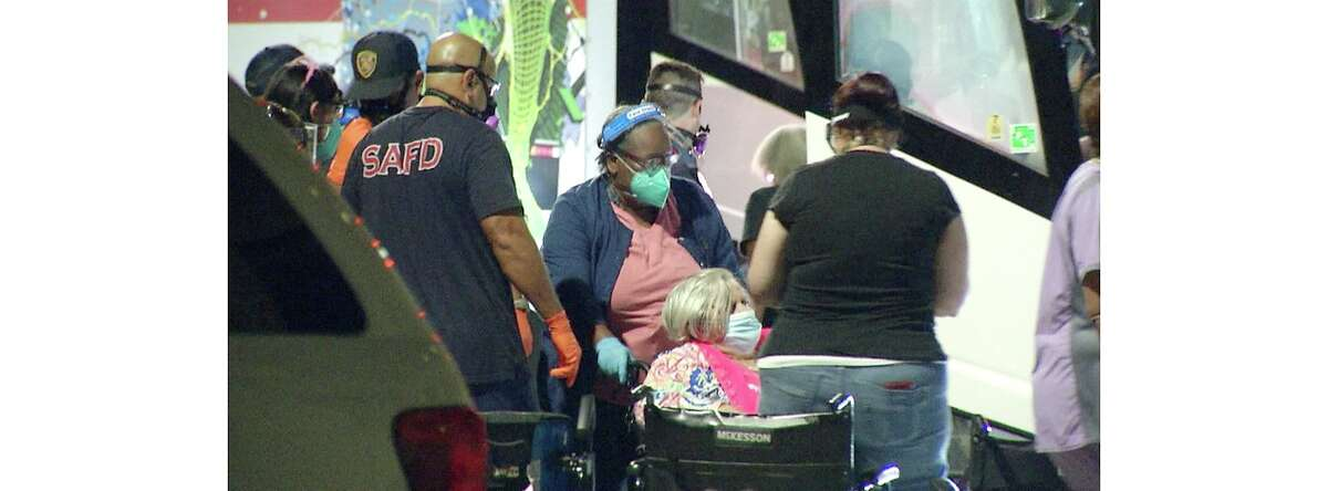 Residents of assisted living centers began evacuating Monday night on large buses, according to local reports.