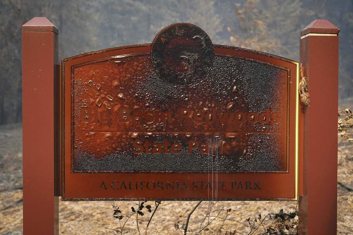 A wildfire-damaged sign welcomes visitors Monday, Aug. 24, 2020, in Big Basin Redwoods State Park, Calif.