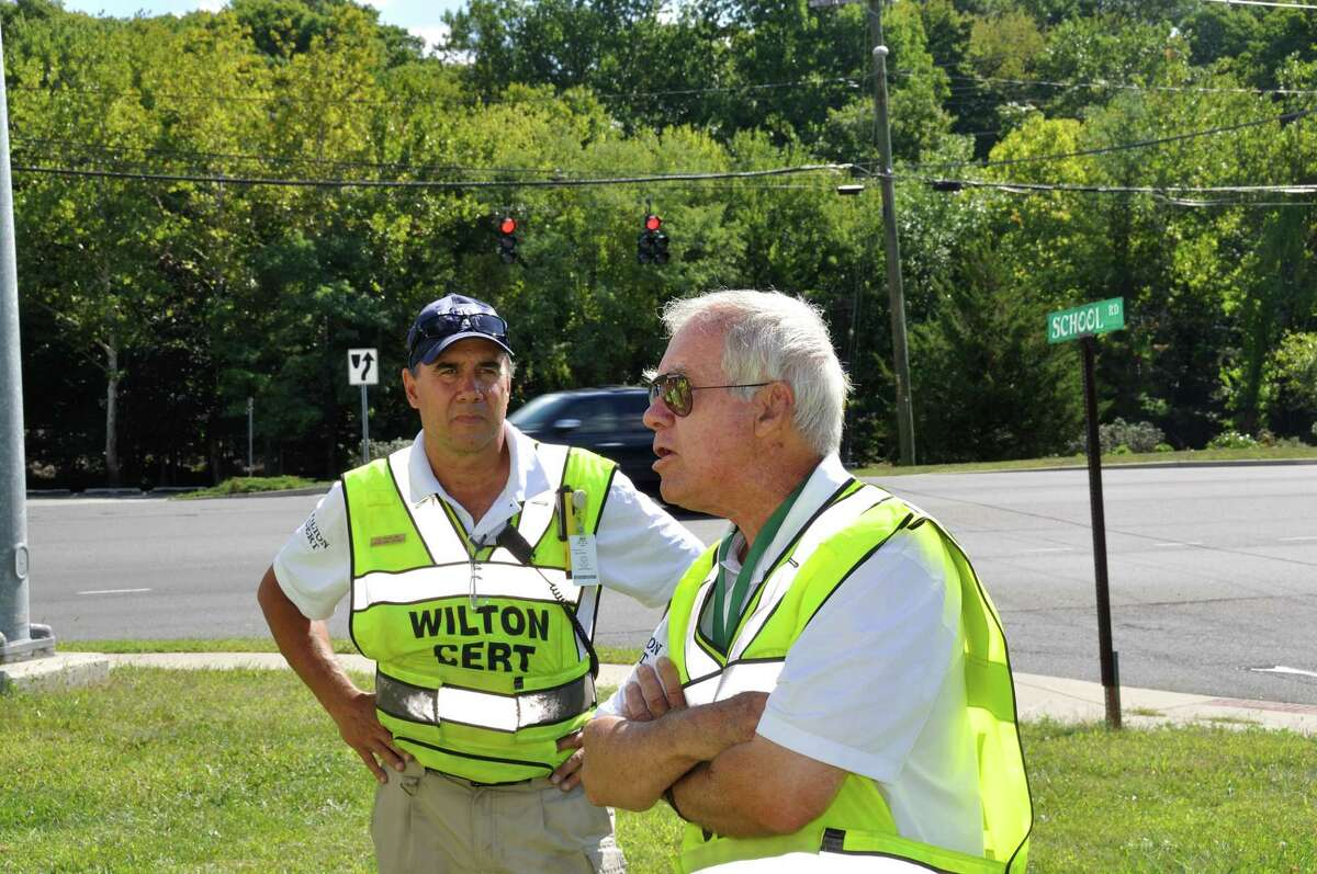T.G. Rawlins, left, listens as Jack Majesky of Wilton CERT goes over instructions before the annual 9/11 motorcycle caravan in a previous year. The all volunteer team with the support of Wilton Emergency Management Director, Police Chief John Lynch, recently completed their annual disaster preparedness training program on Saturday, April 24.