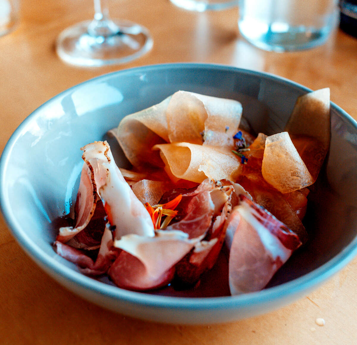 Ribbons of melon with shaved, house-cured speck at The Dutchess hotel. (Photo by Konrad Odhiambo/For the Times Union.)