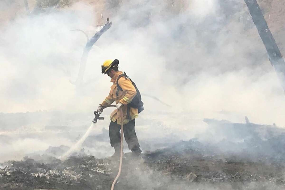 Alameda County firefighters battle the SCU Lightning Complex Fire near Mines Road in Livermore on Aug. 24, 2020.