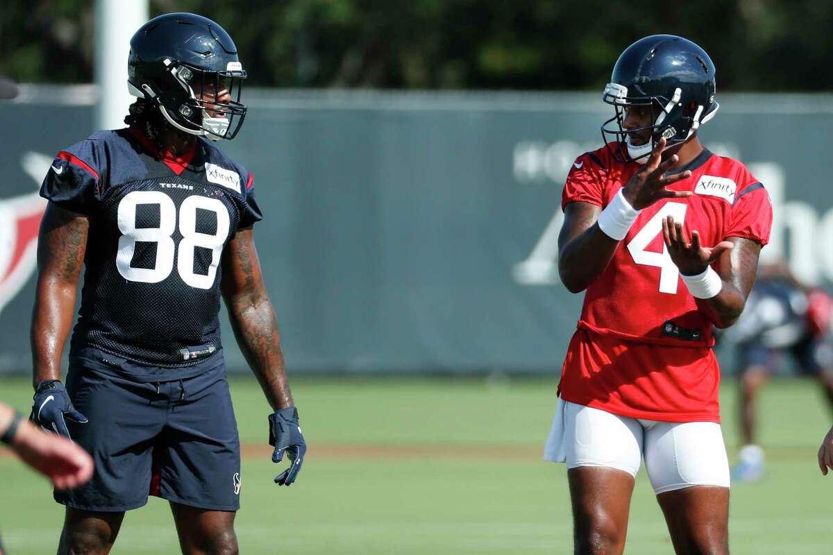 Houston Texans tight end Jordan Akins (88) and quarterback Deshaun Watson (4) talk between drills during an NFL training camp football practice Tuesday, Aug. 25, 2020, in Houston.
