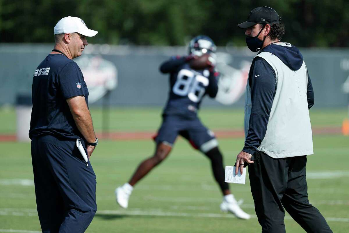 Houston Texans head coach Bill O'Brien, left, talks to offensive coordinator Tim Kelly during an NFL training camp football practice Tuesday, Aug. 25, 2020, in Houston.