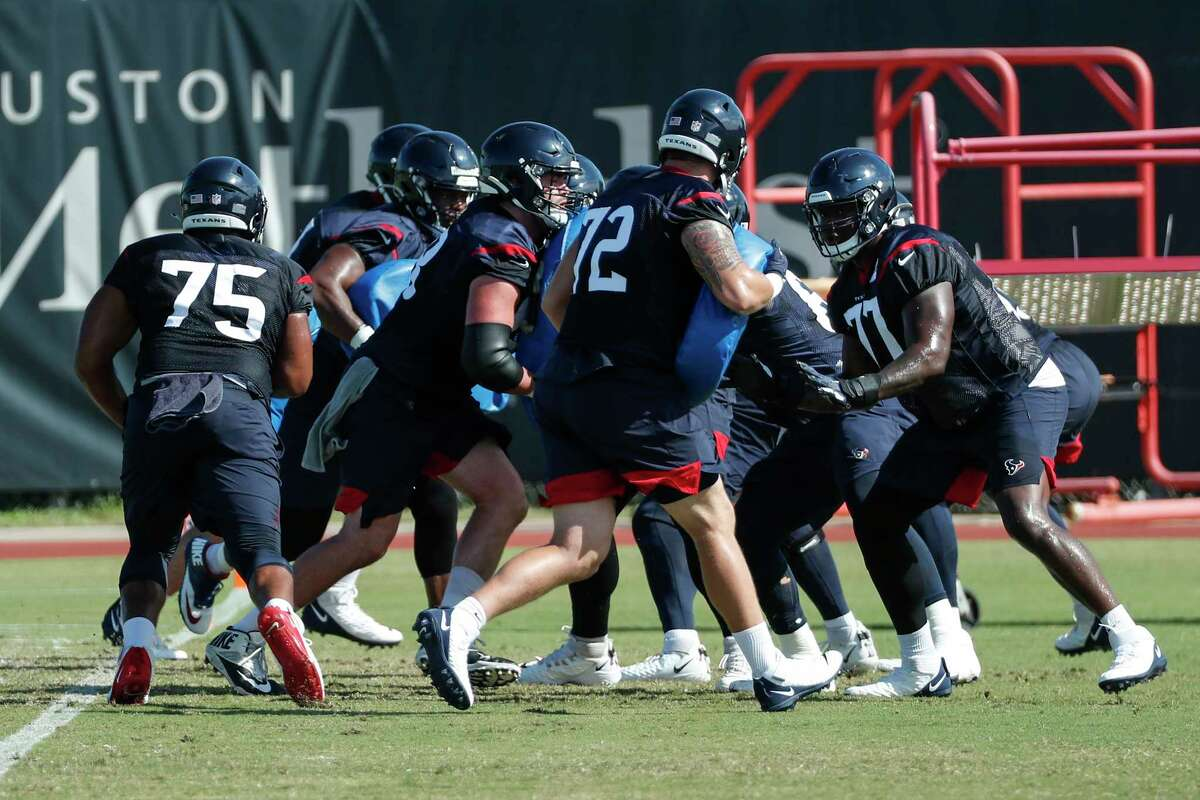 The Houston Texans offensive line run pass blocking drills during an NFL training camp football practice Tuesday, Aug. 25, 2020, in Houston.