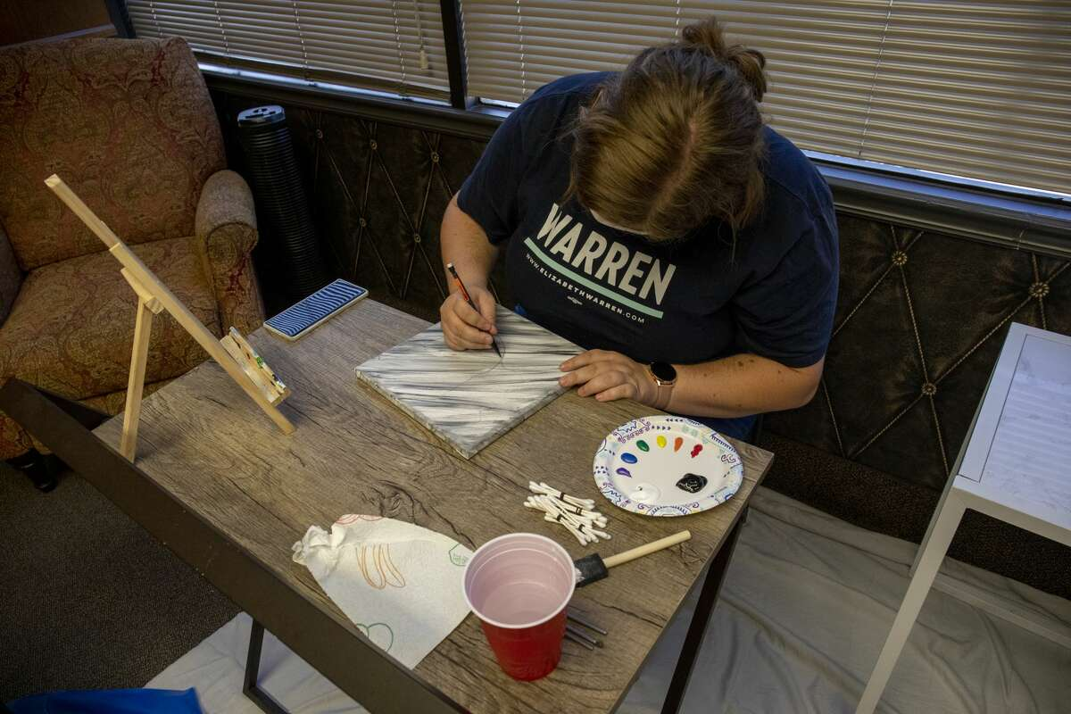 Katelyn Zimmer sketches on a canvas at Pride Center West Texas.