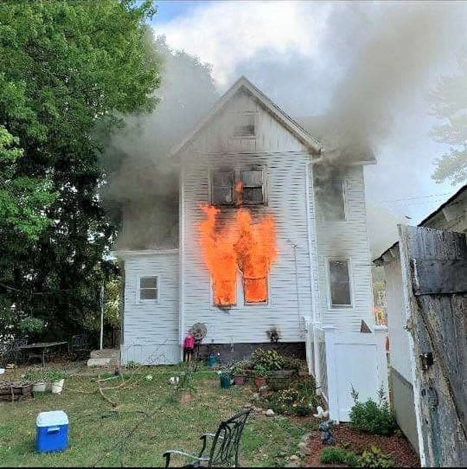 South Fire District firefighters fought a quickly moving blaze at a home on Russell Street Monday afternoon. Photo: South Fire District Photo / Contributed