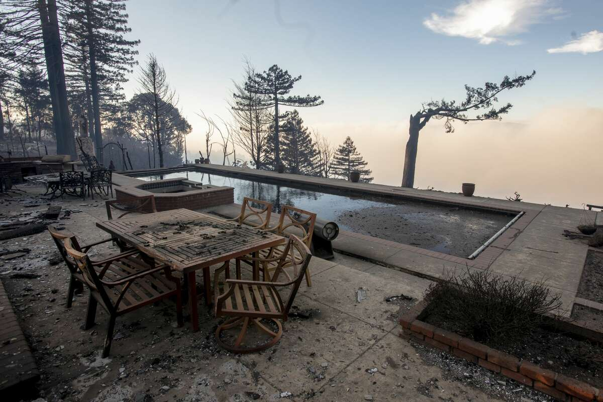 Scenes of total devastation by the CZU Lightning Complex fire are visible along Braemoor Drive in the mountains of Santa Cruz, Calif., Friday, Aug., 21, 2020.