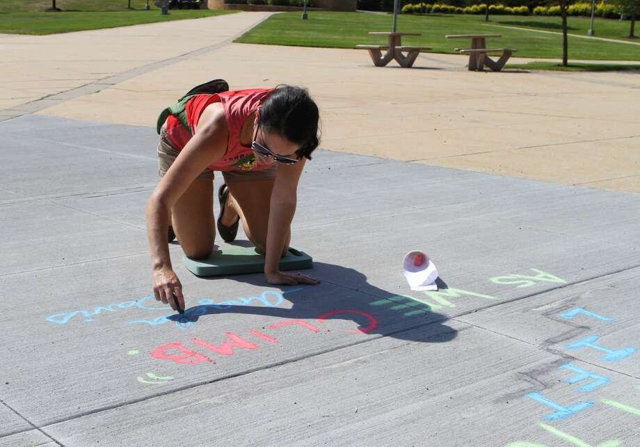 Members of the Ferris State University community covered the Big Rapids campus with messages of inclusion and welcome during the fourth annual Chalk the Walk event. Participants of the event were provided with a list of quotes and messages that aim to make all students feel like they have a place on campus. (Pioneer photos/Taylor Fussman) Photo: (Pioneer Photo/Taylor Fussman)