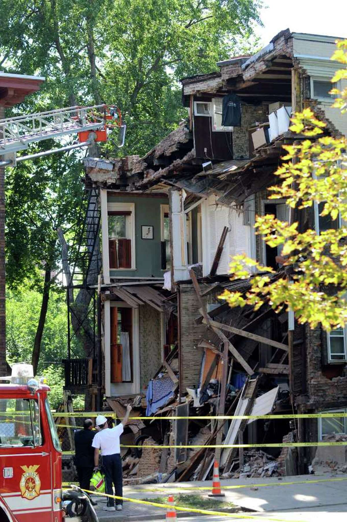 A collapsed wall at at 600 Madison Ave. in Albany, allows a view into four apartments after the east wall of a three-story home collapsed just after 2 p.m. Friday. (Cindy Schultz / Times Union)