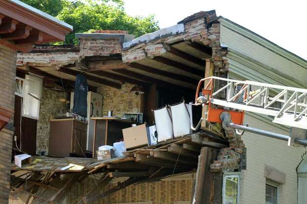 A collapsed wall at 600 Madison Ave. in Albany, allows a look into tenant Natasha Julien's fourth-floor kitchen after the east wall of a three-story home collapsed just after 2 p.m. Friday. (Cindy Schultz / Times Union) Photo: Cindy Schultz