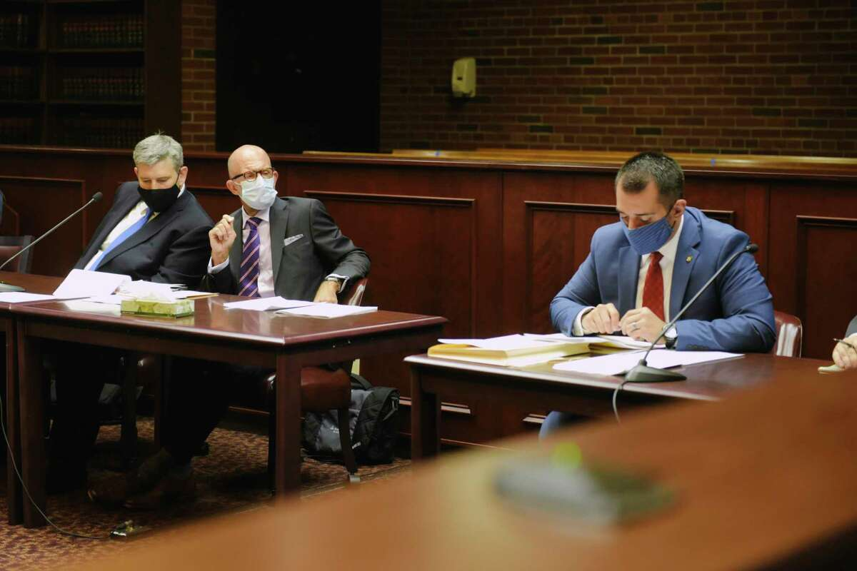 Michael Mann, left, the ex-MyPayrollHR CEO, and his attorney Michael Koenig, appear in Saratoga County Court on Tuesday, Aug. 25, 2020, in Ballston Spa, N.Y. Also pictured is Philip Apruzzese, right, with the New York State Office of the Attorney General. (Paul Buckowski/Times Union)