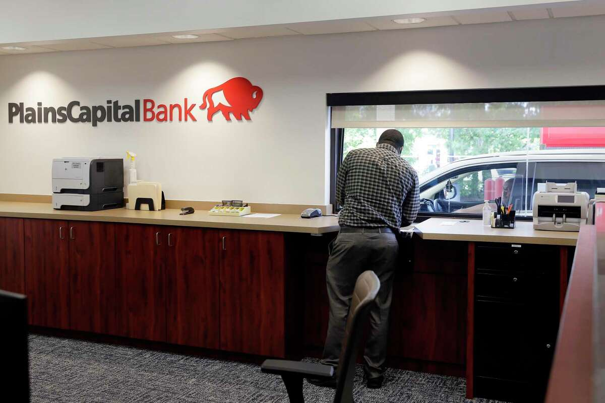 Teller manager Alfred Matthews at the drive up window at the new branch of the PlainsCapital Bank Tuesday, Aug. 25, 2020 in The Woodlands, TX.