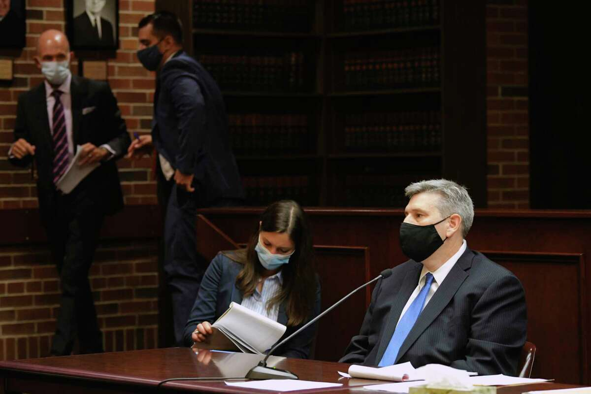 Michael Mann, right, the ex-MyPayrollHR CEO, sits at the defense table as attorneys talk off on the side during a court appearance in Saratoga County Court on Tuesday, Aug. 25, 2020, in Ballston Spa, N.Y. (Paul Buckowski/Times Union)