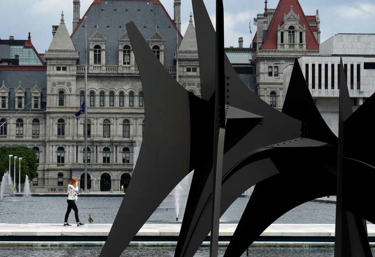"""Alexander Calder's """"Triangles and Arches"""" is back in place at Empire State Plaza on Tuesday, Aug. 25, 2020, in Albany, N.Y. The giant sculpture was reinstalled last week following a two-year absence for restoration. (Will Waldron/Times Union)"""