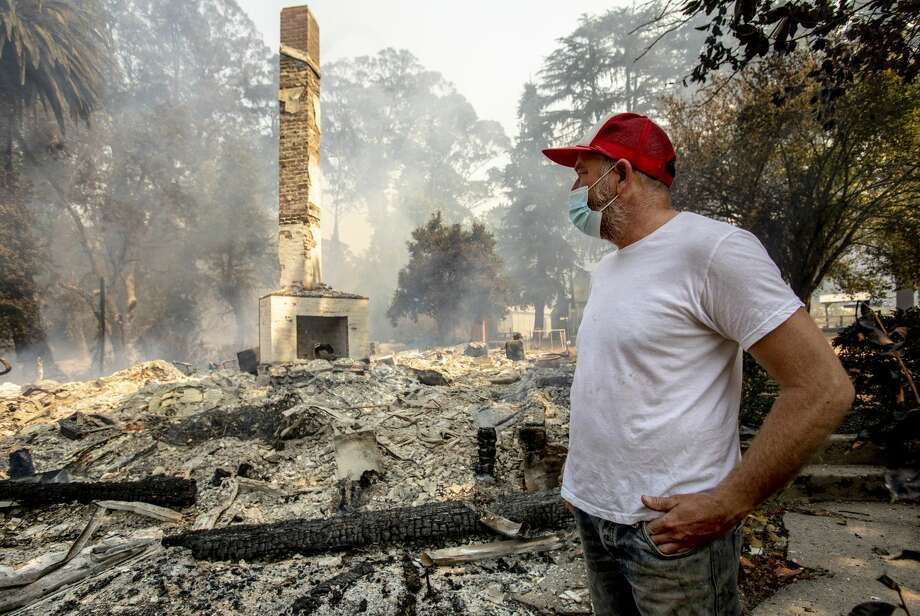 Jered Lawson, co-founder of the non-profit farm education center Pie Ranch, surveys the ruins of their historic 157-year old farmhouse that was destroyed Thursday morning, Aug., 21, 2020, in Pescadero by the CZU Complex fire. Photo: MediaNews Group/The Mercury News/MediaNews Group Via Getty Images / Bay Area News Group - Digital First Media