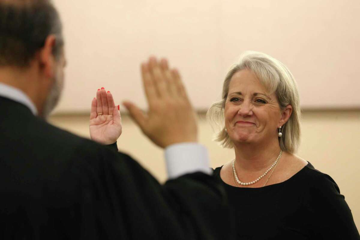 Melisa Skinner is sworn in as the Bexar County 144th state District Court judge by 379th state District Court Judge Ron Rangel. She was appointed to the bench by Gov. Greg Abbott.