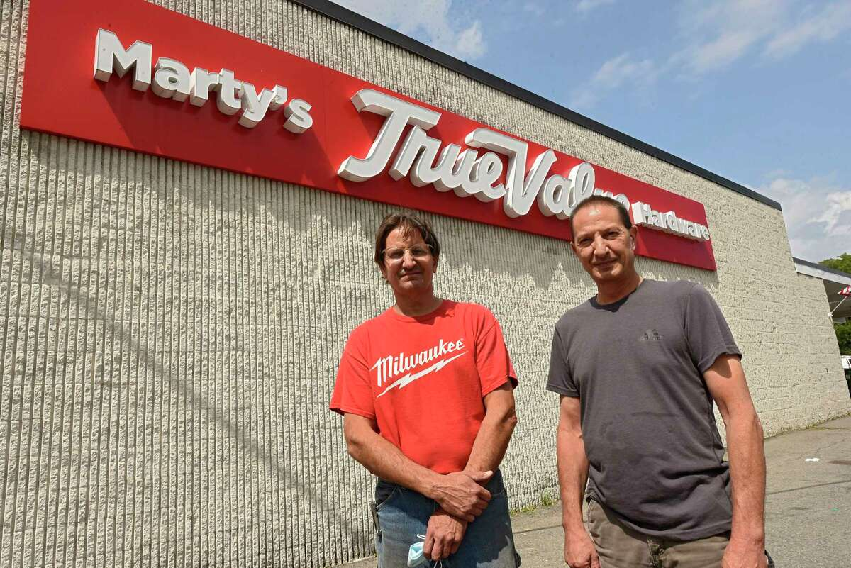 Mike Aragosa, left, and Joe Aragosa stand in front of Marty's True Value Hardware which they are planning on closing on Tuesday, Aug. 25, 2020 in Schenectady, N.Y. They are two of the three siblings who run this family business and are planning to sell and retire. (Lori Van Buren/Times Union)